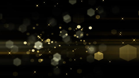 Beautiful Golden Bokeh Hexagons and Particle in a Black Glamours Background Live Action
