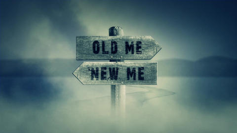 Old Wooden Sign on a Middle of a Cross Road With the Words Old Me or New Me Footage