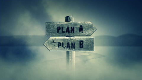 Old Wooden Sign on a Middle of a Cross Road With the Words Plan A or Plan B Live Action
