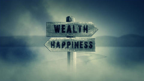 Old Wooden Sign on a Middle of a Cross Road With the Words Wealth or Happiness Filmmaterial