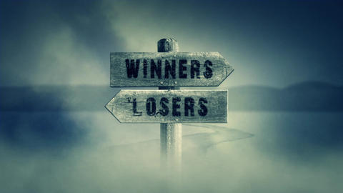 Old Wooden Sign on a Middle of a Cross Road With the Words Winners or Losers Live Action