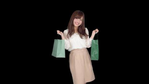Young Japanese woman shopping with colorful bag 5 GIF
