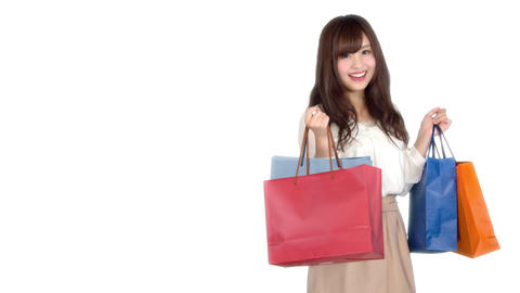 Young Japanese woman shopping with colorful bag 2 Bild
