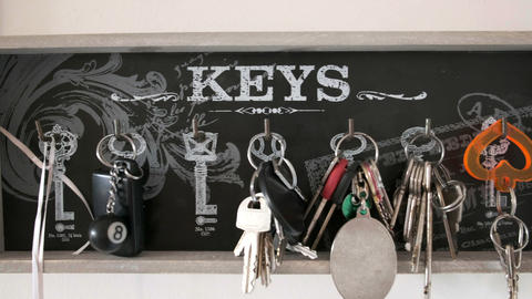 key hanger horizontal panning background of many keychains in holiday home Live Action