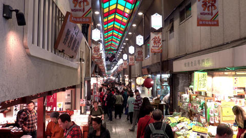 Tourists and shoppers on Nishiki market shopping street district, Kyoto, Japan Live Action