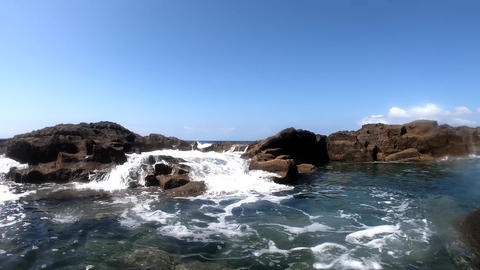 Waves by Alghero rocky shore under a clear sky Live Action