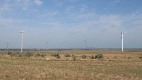 Work of the group of wind power. Wind power generator installed in the field Live Action