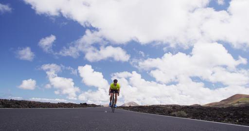 Road bike cyclist man biking on professional racing bike - Sports fitness video Live Action