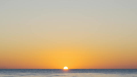 Amazing sunrise on the beach. Orange color of sunrise and waves. Yellow hot sky Live Action