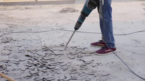 employees with jackhammer and brush remove concrete on floor Live Action