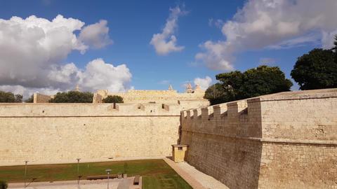 Walls of Ancient Mdina Fortification in Rabat, Malta Under Bright Summer Sky Live Action