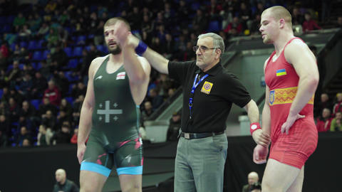 The referee raises the winner's hand. Wrestling. Victory. Winner. Success Live Action