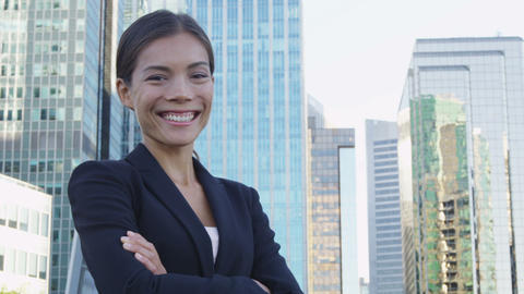Business woman portrait of young female urban professional businesswoman in suit Live Action