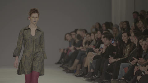 Fashion show. The girl is a model on the catwalk Live Action