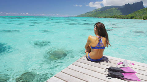 Luxury lifestyle vacation holiday travel bikini woman relaxing after snorkel Live Action