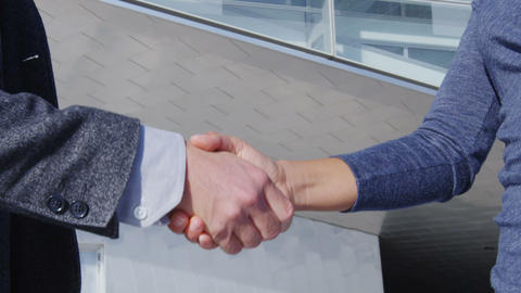 Handshake - business people shaking hands, business man and business woman Live Action