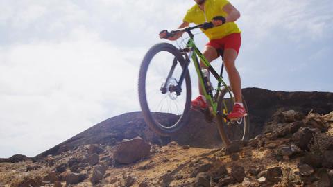 Mountain biker biking on MTB bike cycling trail Live Action
