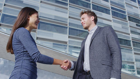 Business Handshake - business people shaking hands, business man and woman Live Action