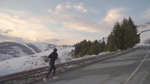 Energetic female sprinting to the mountain top, to Arc of Freedom in Bulgaria in Live Action