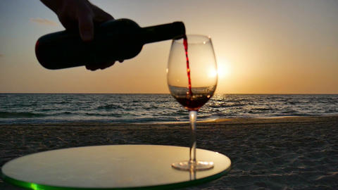 Man Pouring Wine Into a Glass at Sunset Live Action