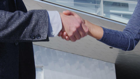 Business Handshake - business people meeting shaking hands, man and woman Live Action