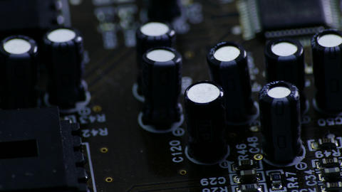 4K Ungraded: Rotating Printed Circuit Board With Microprocessors and Capacitors Footage