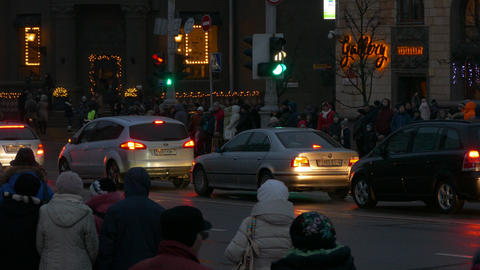 4K Ungraded: Crowd of People Walking on Night Winter Street With Festive Footage