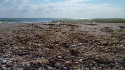 Sea view from the shore of shells, shot from below Archivo