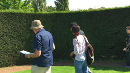 Chinese tourists at English garden Kent UK Footage