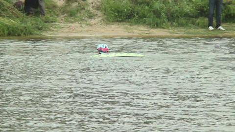 Fallen wake boarder swims back shore with board helmet failed Footage