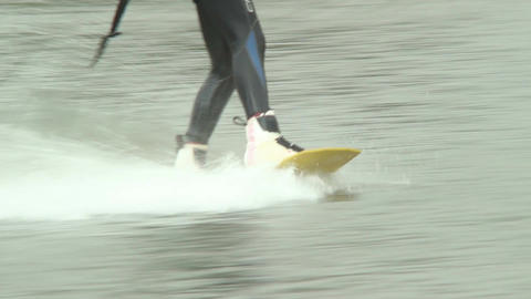 Funny wakeboarder male with lifebuoy rides towered by cable Footage