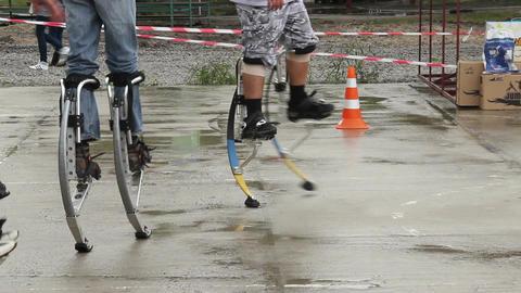 Men with jumping stilts walk, jump, train, run, exercise steel Footage