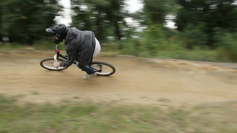 BMX rider races difficult track in helmet, spinning pedals Footage