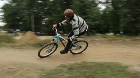 Competition bicycle BMX bikes racer rides difficult track helmet Footage
