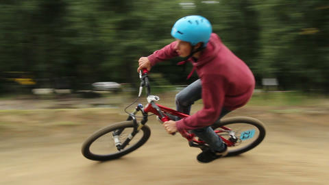 Tracking shot of BMX bicycle in competition racing to win Footage