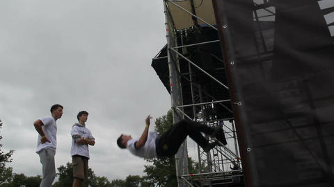 Super high jumps on trampoline, performer climbs up the wall Live Action