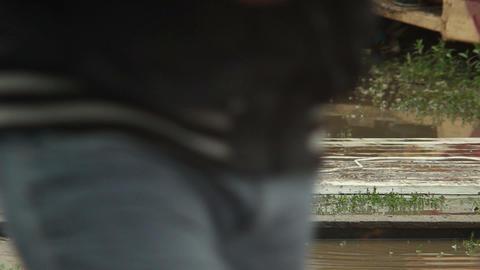Backwash of flood, people legs walking on puddles climate change Footage