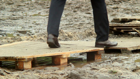 Footsteps of businessman over dirt, crisis overcome concept Footage