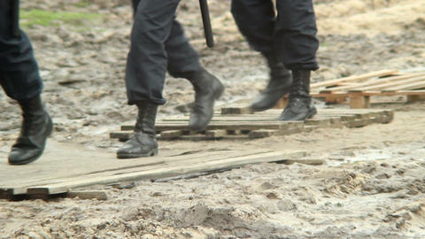 Military forces boots step over dirt, rescue emergency situation Footage