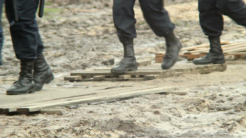 Slow motion of military soldiers massive boots in dirt Footage