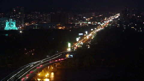 Nightlife city timelapse, cars moving across river bridge lights Footage