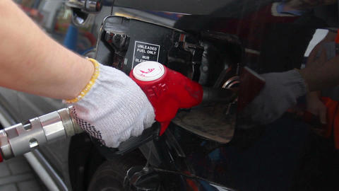 Fueling station service man glove pulls out pistol car gas Footage