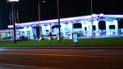 Gas station at night, contemporary petrol service cars drive in Footage