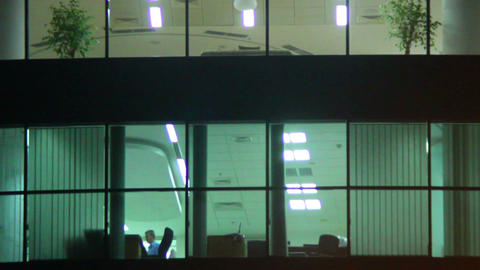 Office windows night shift, business center floor, rooms light Footage