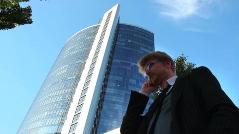 Businessman receives phone call business center low angle shot Footage