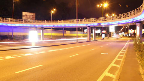 City bridge time lapse, cars drive lights colorful, red yellow Footage