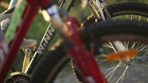 Young couple rides two bicycles, man woman romantic together Footage