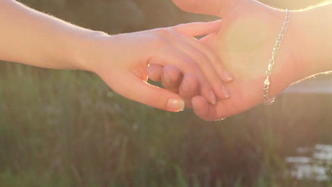 Love, friendship sign, man and women holding hands together Footage