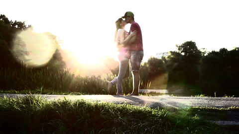 Silhouette passionate love kiss by young couple male and female Footage