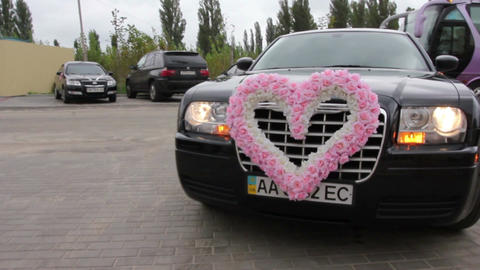 Luxury marriage car drives on camera, stops, love heart sign Footage